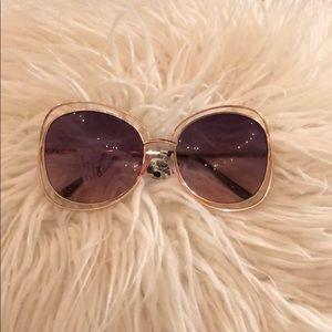 Rose gold framed, purple lenses sunglasses